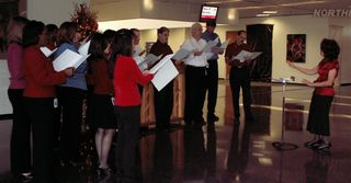 Gretchen leading employee choir