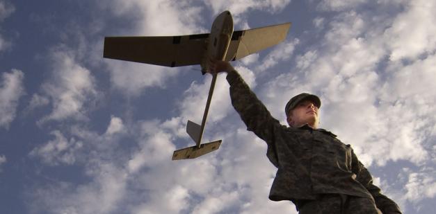 Soldier-holding-uav