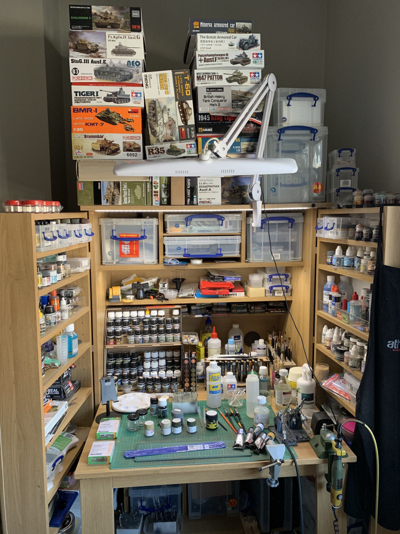 Paint bench with stash of models waiting for build